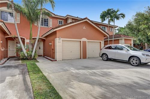 Photo of 1012 NW 100th Ave, Pembroke Pines, FL 33024 (MLS # A11089846)
