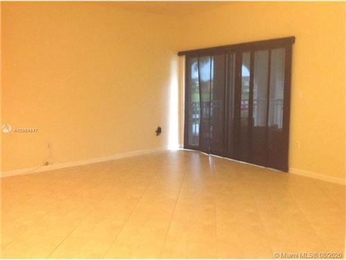Photo of 11401 NW 89th St #210, Doral, FL 33178 (MLS # A10904847)