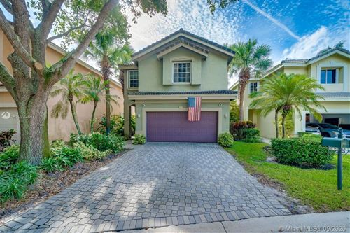 Photo of 143 NW 107th Ter, Plantation, FL 33324 (MLS # A10932847)
