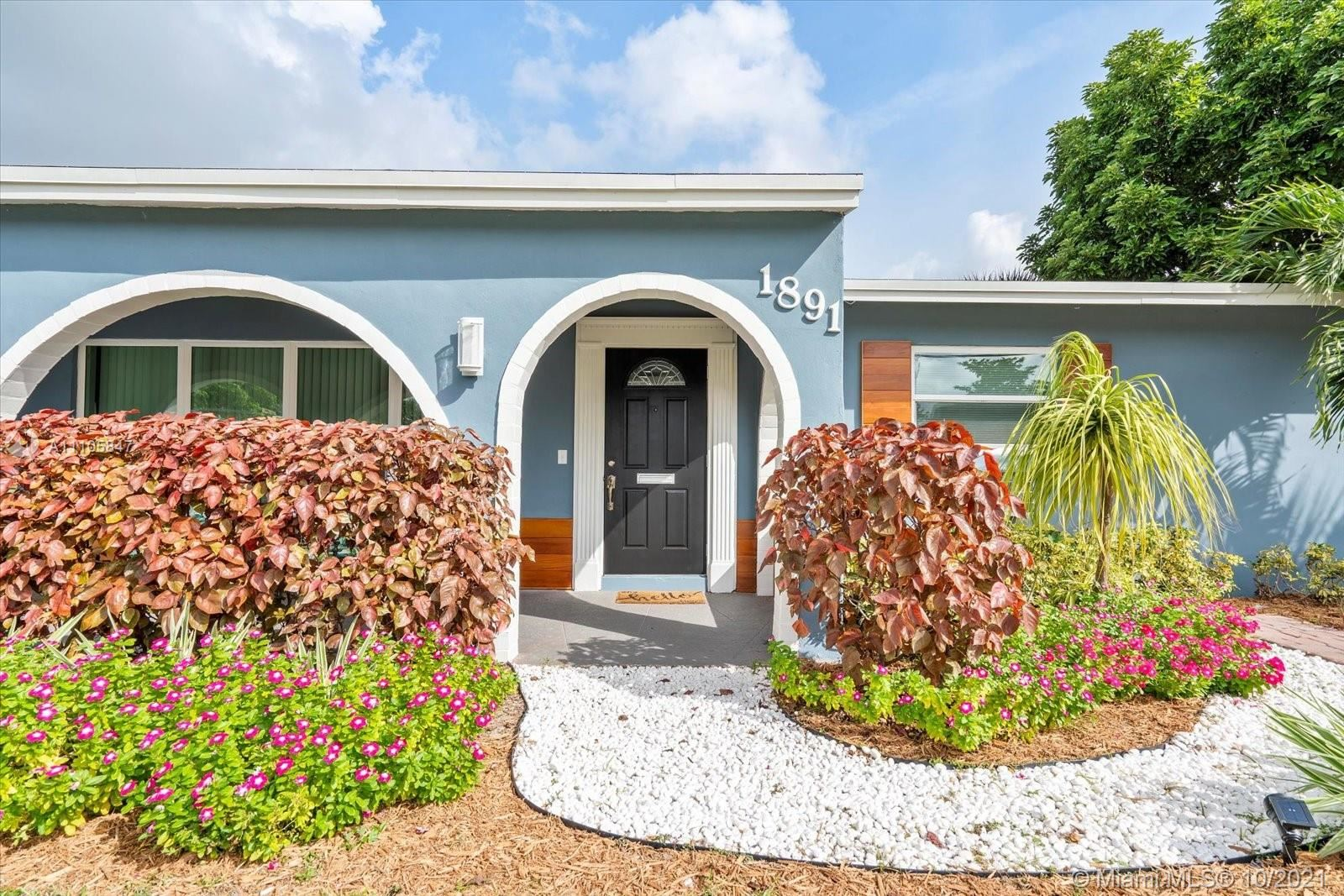 Photo of 1891 NW 31st Ct, Oakland Park, FL 33309 (MLS # A11105847)