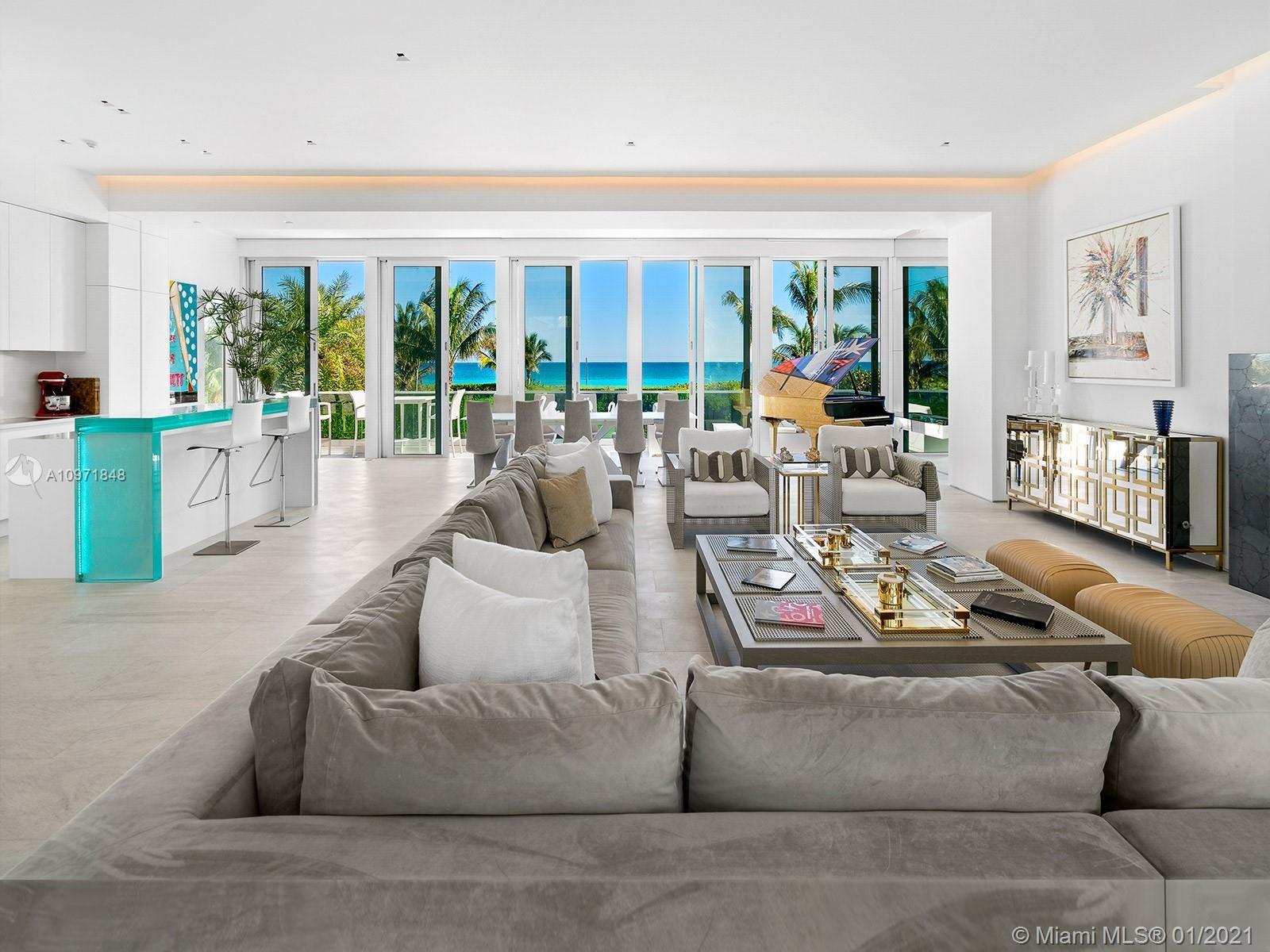 Photo of 7815 Atlantic Way, Miami Beach, FL 33141 (MLS # A10971848)
