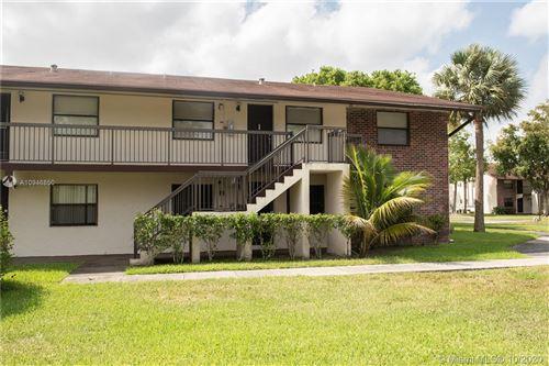 Photo of 6040 Shakerwood Cir #208, Tamarac, FL 33319 (MLS # A10946850)