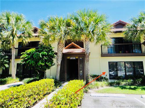 Photo of 1102 Duncan Cir #104, Palm Beach Gardens, FL 33418 (MLS # A11054851)