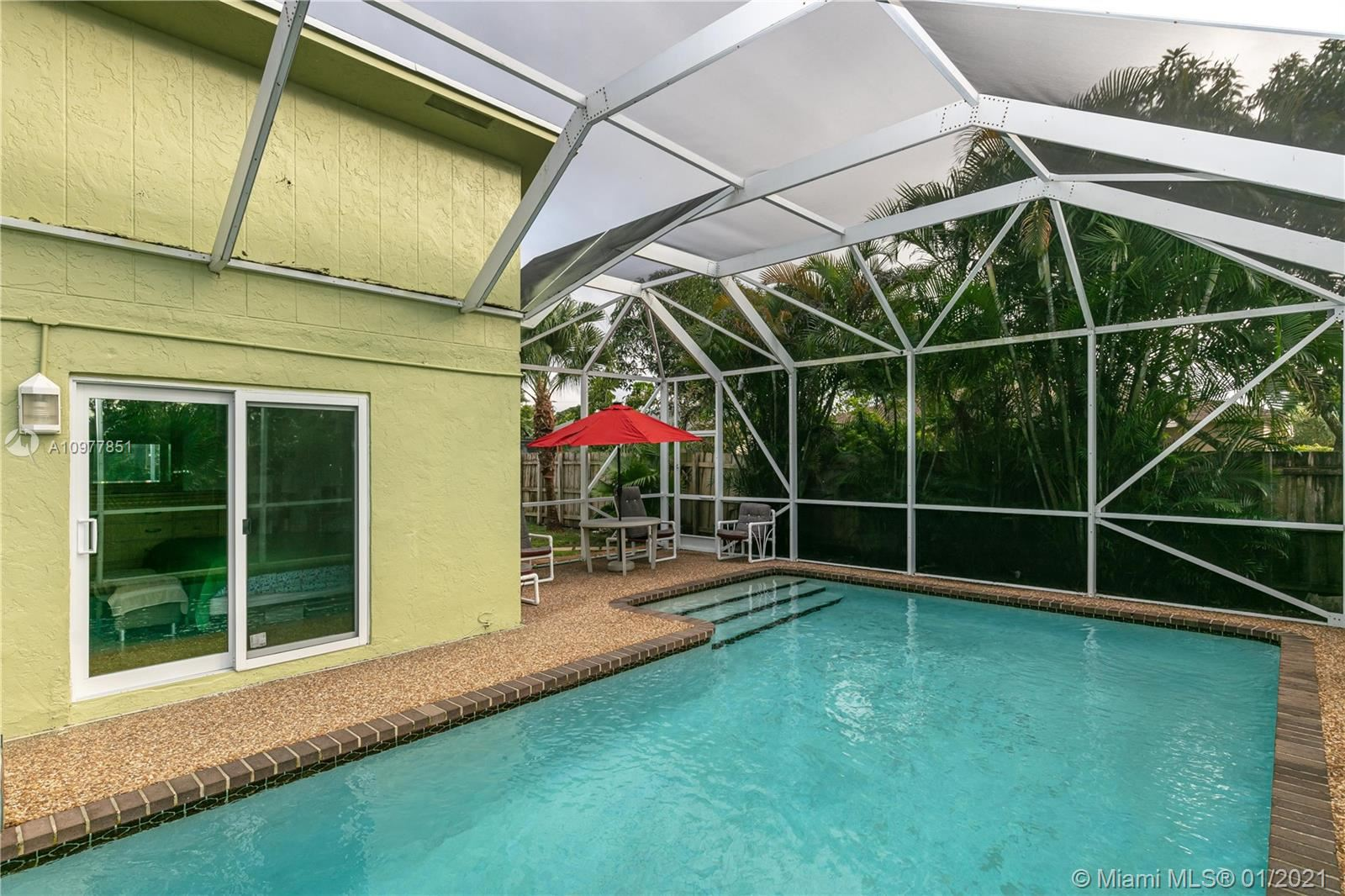 Photo of 8130 SW 9th St, North Lauderdale, FL 33068 (MLS # A10977851)