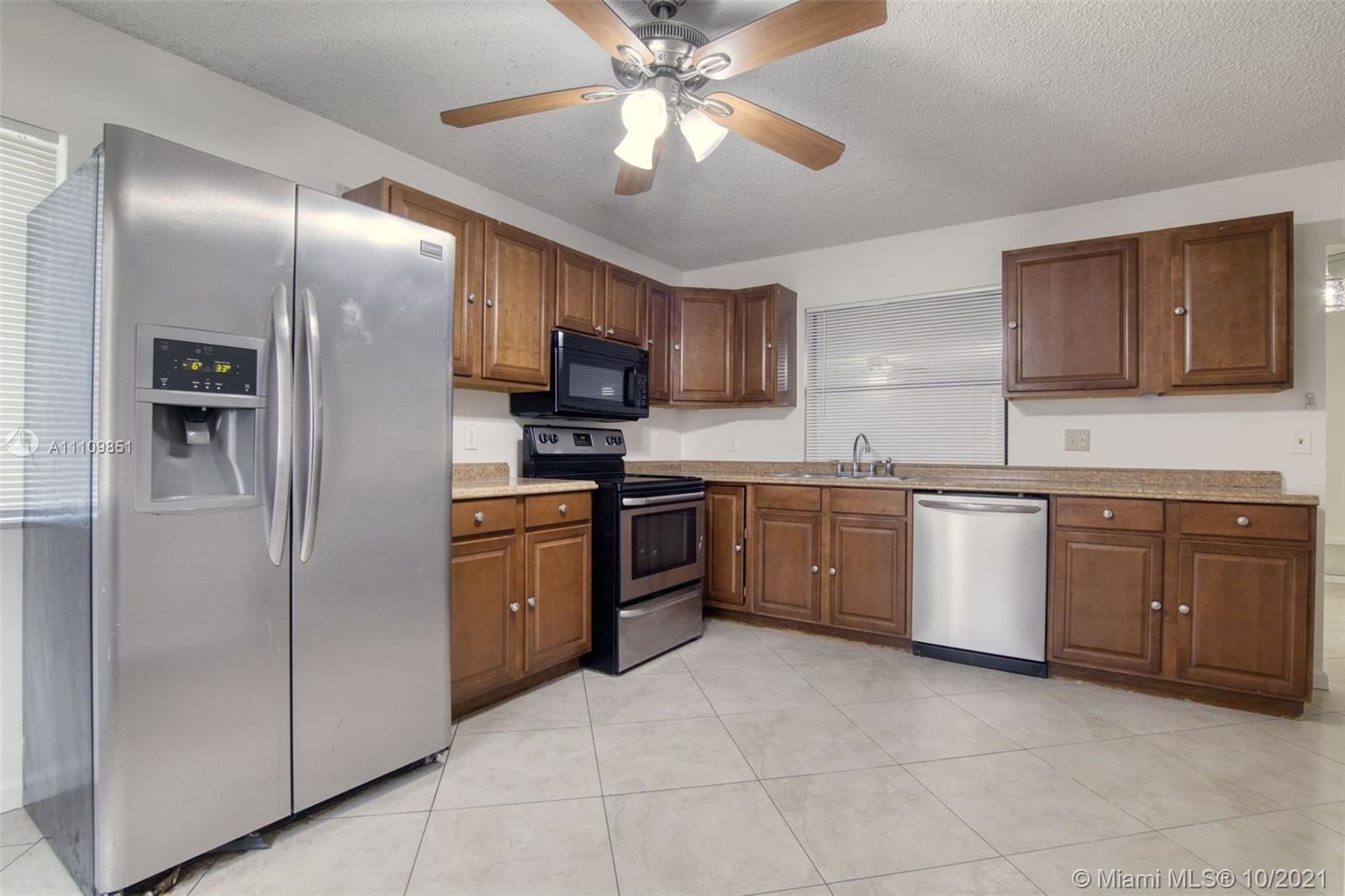 Photo of 2938 NW 51st Ter, Margate, FL 33063 (MLS # A11109851)