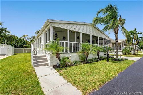 Photo of 6881 NW 45th Terrace, Coconut Creek, FL 33073 (MLS # A11041852)