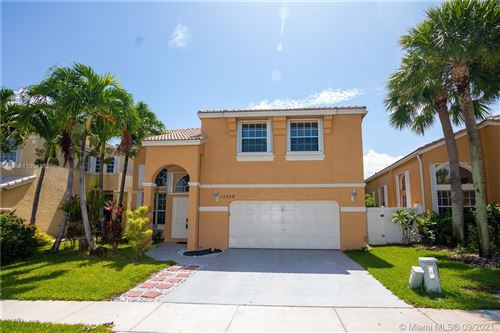 Photo of 15558 NW 12th Ct, Pembroke Pines, FL 33028 (MLS # A11094852)