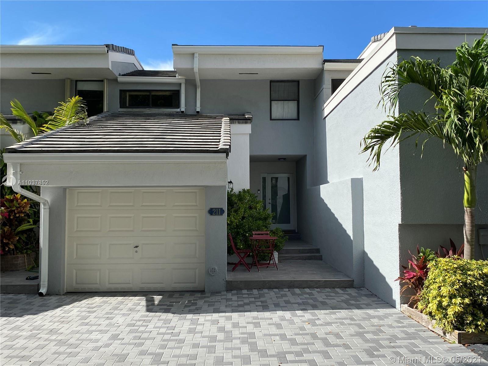 Photo of 211 Poinciana Dr #201, Sunny Isles Beach, FL 33160 (MLS # A11037852)