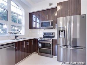Photo of 3001 NE 185th St #117, Aventura, FL 33180 (MLS # A10876853)