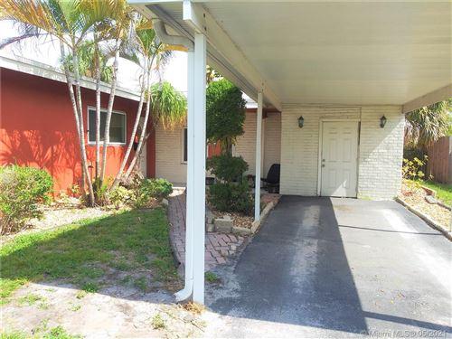 Photo of 4521 W Oakland Park Blvd, Lauderdale Lakes, FL 33313 (MLS # A11032854)
