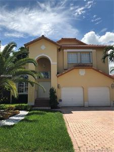 Photo of 10940 NW 58th Terrace, Doral, FL 33178 (MLS # A10442856)