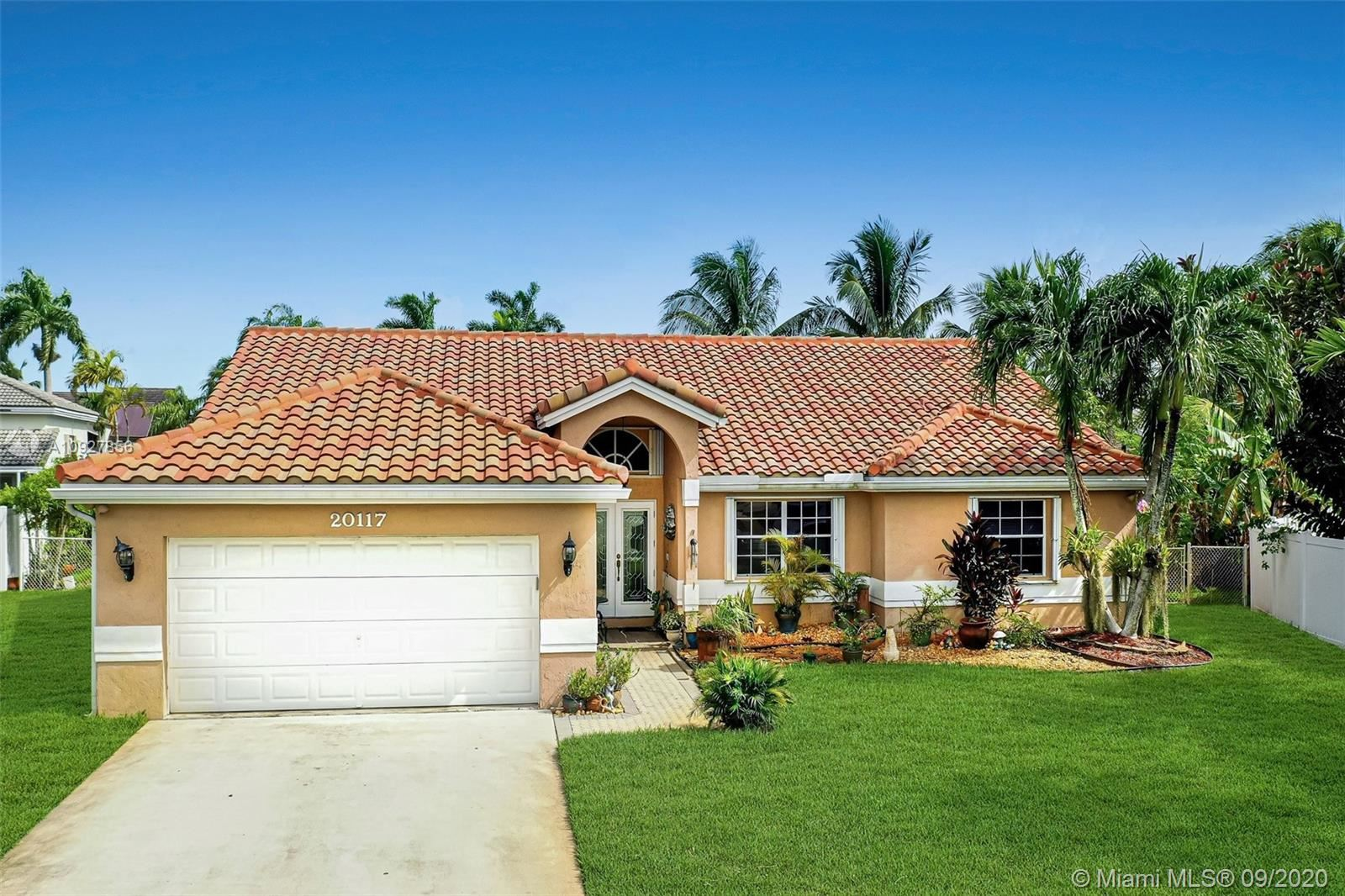 Photo of 20117 NW 9th Ct, Pembroke Pines, FL 33029 (MLS # A10927856)