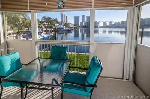 Photo of 462 Golden Isles Dr #102, Hallandale Beach, FL 33009 (MLS # A10949862)