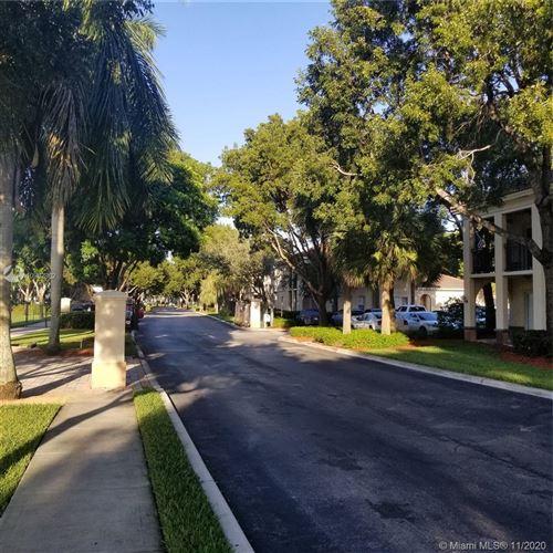 Photo of 2433 Centergate Dr #101, Miramar, FL 33025 (MLS # A10962862)