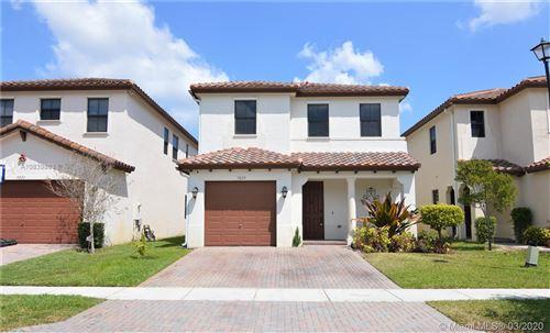 Photo of 9229 SW 39th St, Miramar, FL 33025 (MLS # A10839863)