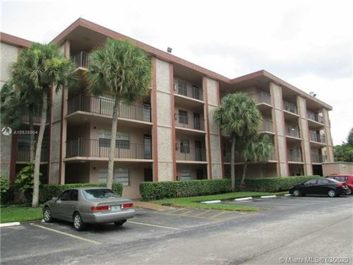 Photo of 3070 NW 48th Ter #103, Lauderdale Lakes, FL 33313 (MLS # A10828864)