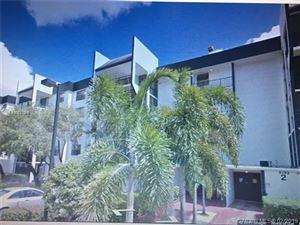 Photo of 6195 Rock Island Rd #405, Tamarac, FL 33319 (MLS # A10617866)