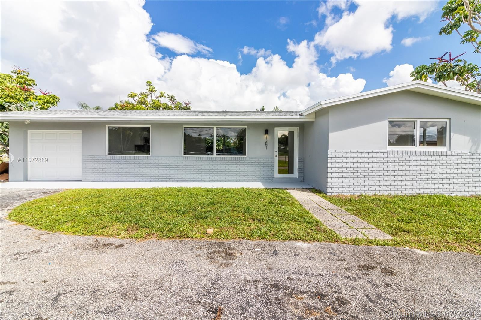 Photo of 1251 NW 60th Ave, Sunrise, FL 33313 (MLS # A11072869)