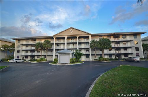 Photo of 1512 Whitehall Dr #306, Davie, FL 33324 (MLS # A10722872)