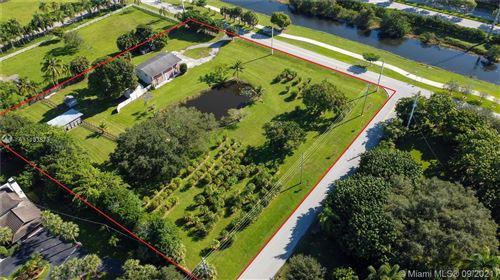 Photo of 1201 Old Hiatus Rd, Plantation, FL 33323 (MLS # A11103873)