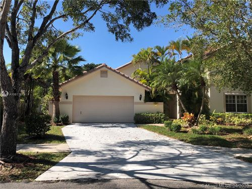 Photo of 1975 Lake Point Dr, Weston, FL 33326 (MLS # A10617874)
