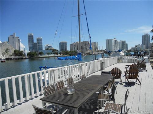 Photo of 6865 Bay Dr #9, Miami Beach, FL 33141 (MLS # A11056874)