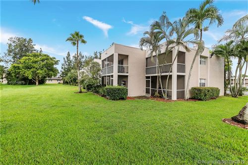Photo of 8509 Old Country Mnr #301, Davie, FL 33328 (MLS # A10740875)