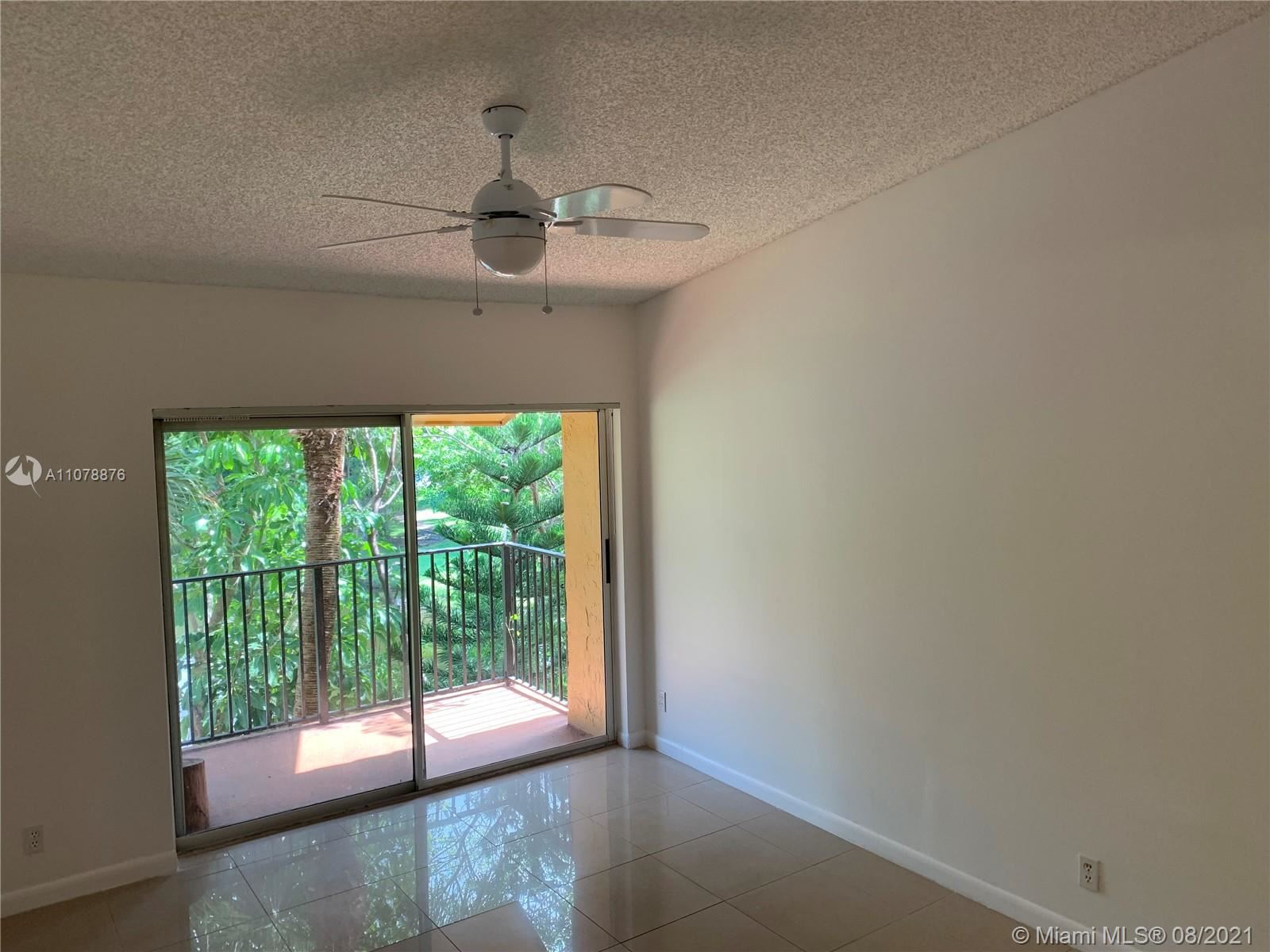 Photo of 10749 Cleary Blvd #310, Plantation, FL 33324 (MLS # A11078876)