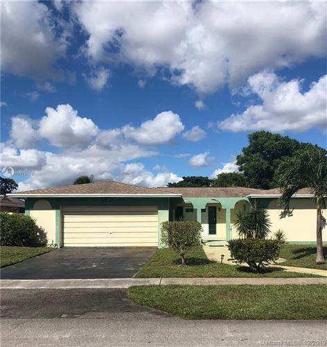 Photo of 7741 NW 44th Ct, Lauderhill, FL 33351 (MLS # A10778880)