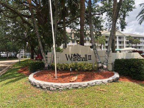 Photo of 1715 Whitehall Dr #404, Davie, FL 33324 (MLS # A11035880)