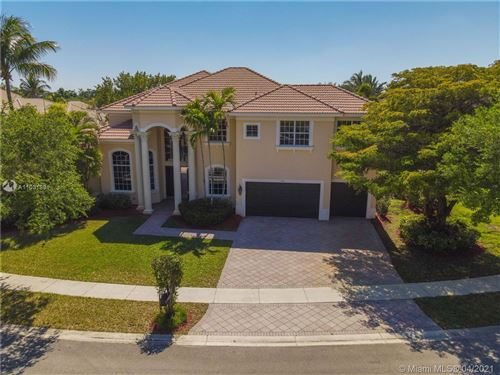 Photo of 7141 NW 70th Ter, Parkland, FL 33067 (MLS # A11031881)