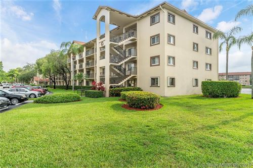 Photo of 1351 SW 141st Ave #208G, Pembroke Pines, FL 33027 (MLS # A11058885)