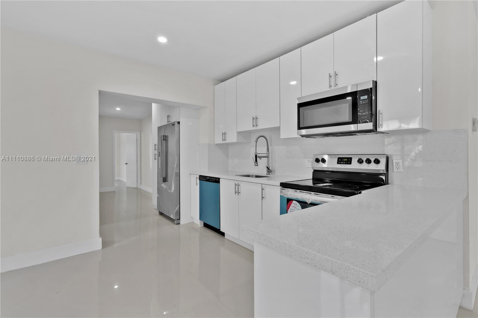 Photo of 1424 NE 1st Ave, Fort Lauderdale, FL 33304 (MLS # A11110886)