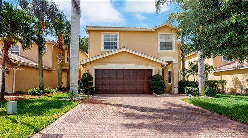 Photo of 7856 Red Mahogany Rd, Boynton Beach, FL 33437 (MLS # A11021887)