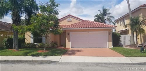 Photo of 580 NW 166th Ave, Pembroke Pines, FL 33028 (MLS # A11098887)