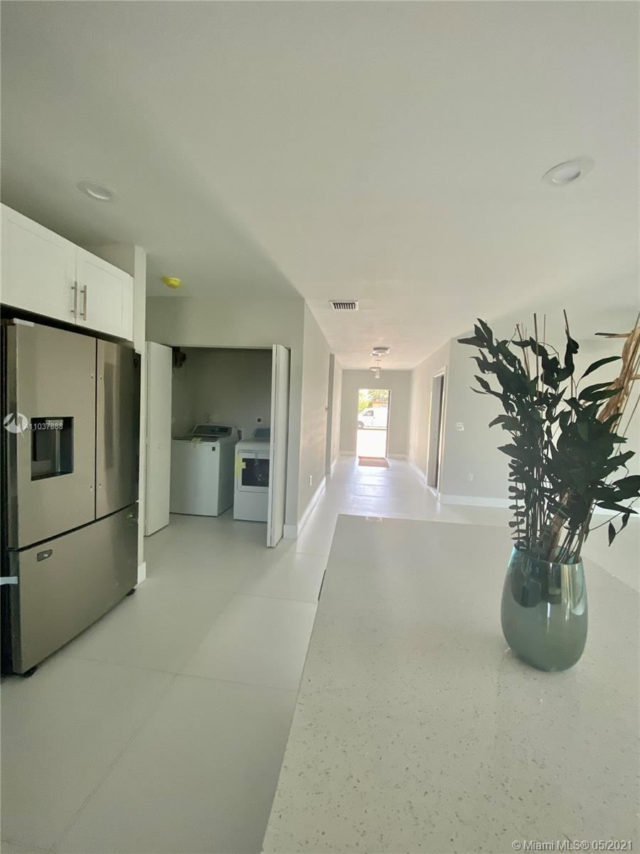 Photo of 210 W 37 St, Riviera Beach, FL 33404 (MLS # A11037888)