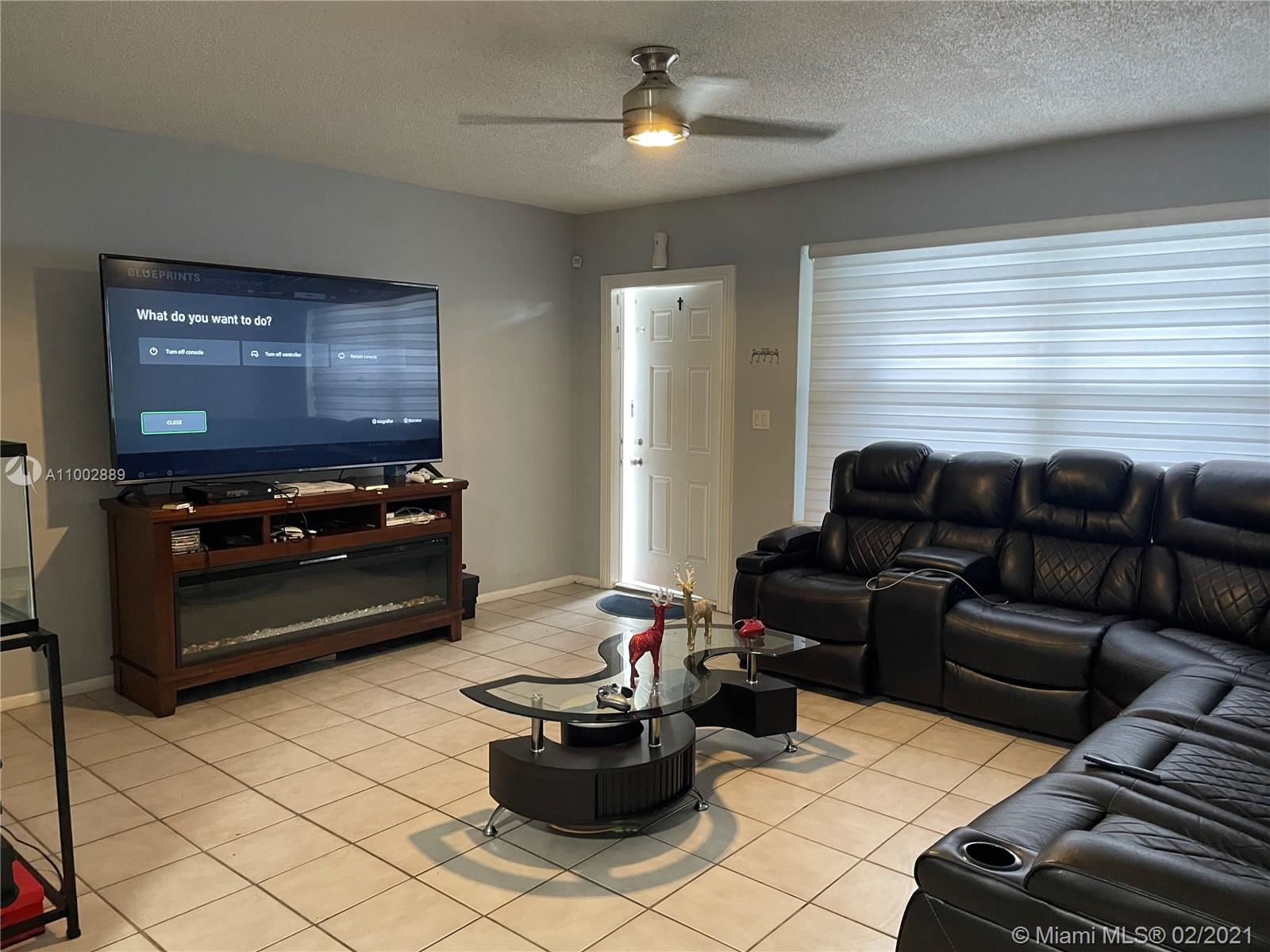 Photo of 2221 NW 82nd Ave, Sunrise, FL 33322 (MLS # A11002889)