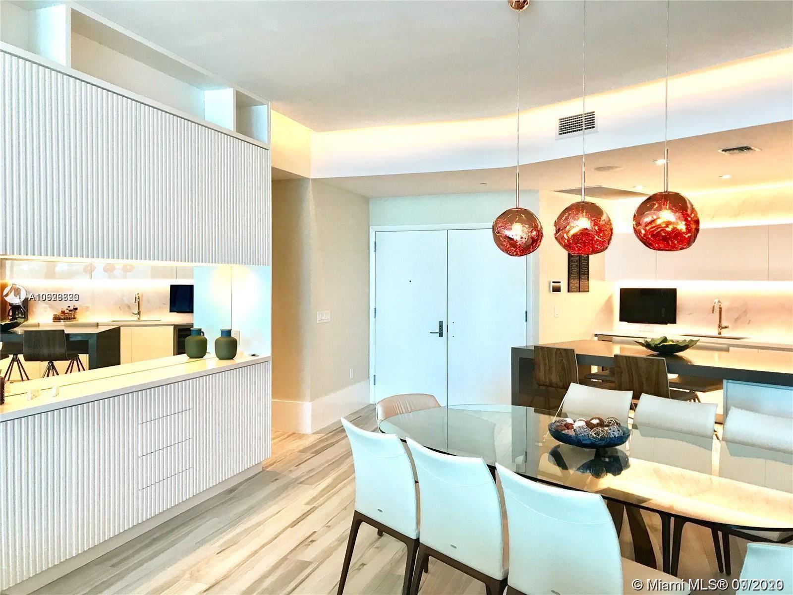 Photo of 701 N Fort Lauderdale Blvd #403, Fort Lauderdale, FL 33304 (MLS # A10929890)