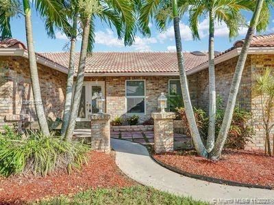 Photo of 3936 NW 22nd St, Coconut Creek, FL 33066 (MLS # A10961892)