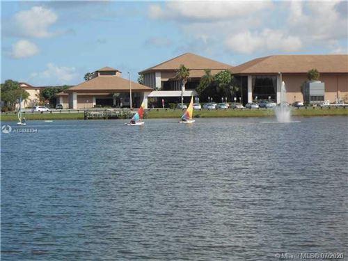Photo of 12650 SW 6th St #213K, Pembroke Pines, FL 33027 (MLS # A10888894)