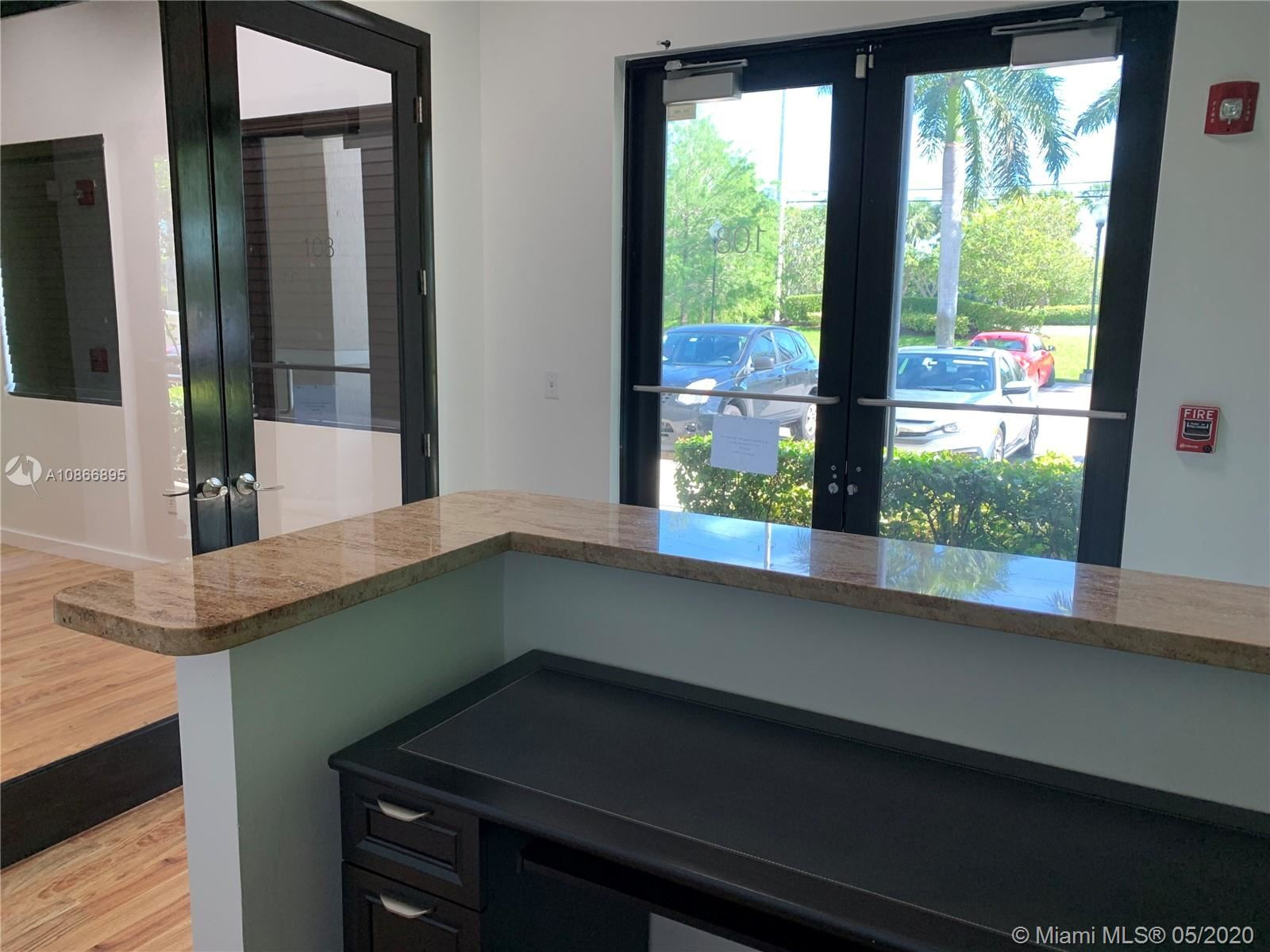 Photo of 10620 Griffin Rd #B-108, Cooper City, FL 33328 (MLS # A10866895)