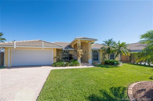 Photo of 14233 SW 152nd Ct, Miami, FL 33196 (MLS # A10964896)