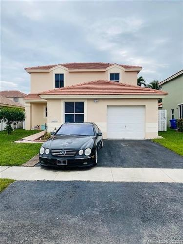 Photo of 18570 NW 22nd Ct, Pembroke Pines, FL 33029 (MLS # A10981897)