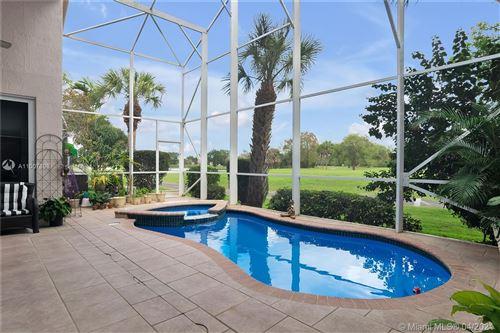 Photo of 1551 E Lacosta Dr E, Pembroke Pines, FL 33027 (MLS # A11007898)