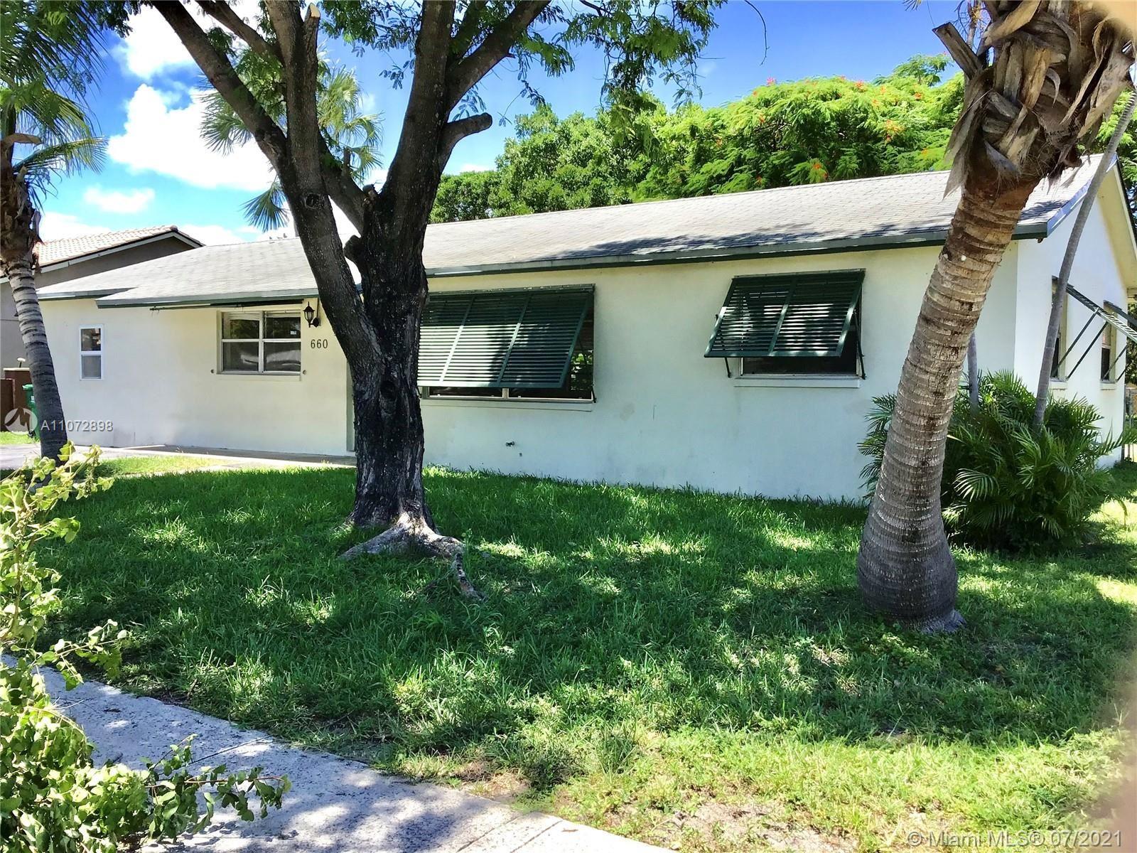 Photo of 660 W 36th St, Riviera Beach, FL 33404 (MLS # A11072898)