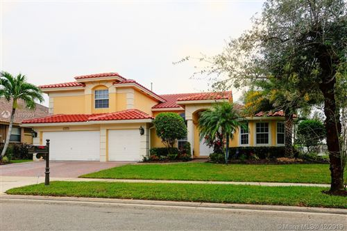 Photo of 13072 NW 23rd St, Pembroke Pines, FL 33028 (MLS # A10790904)
