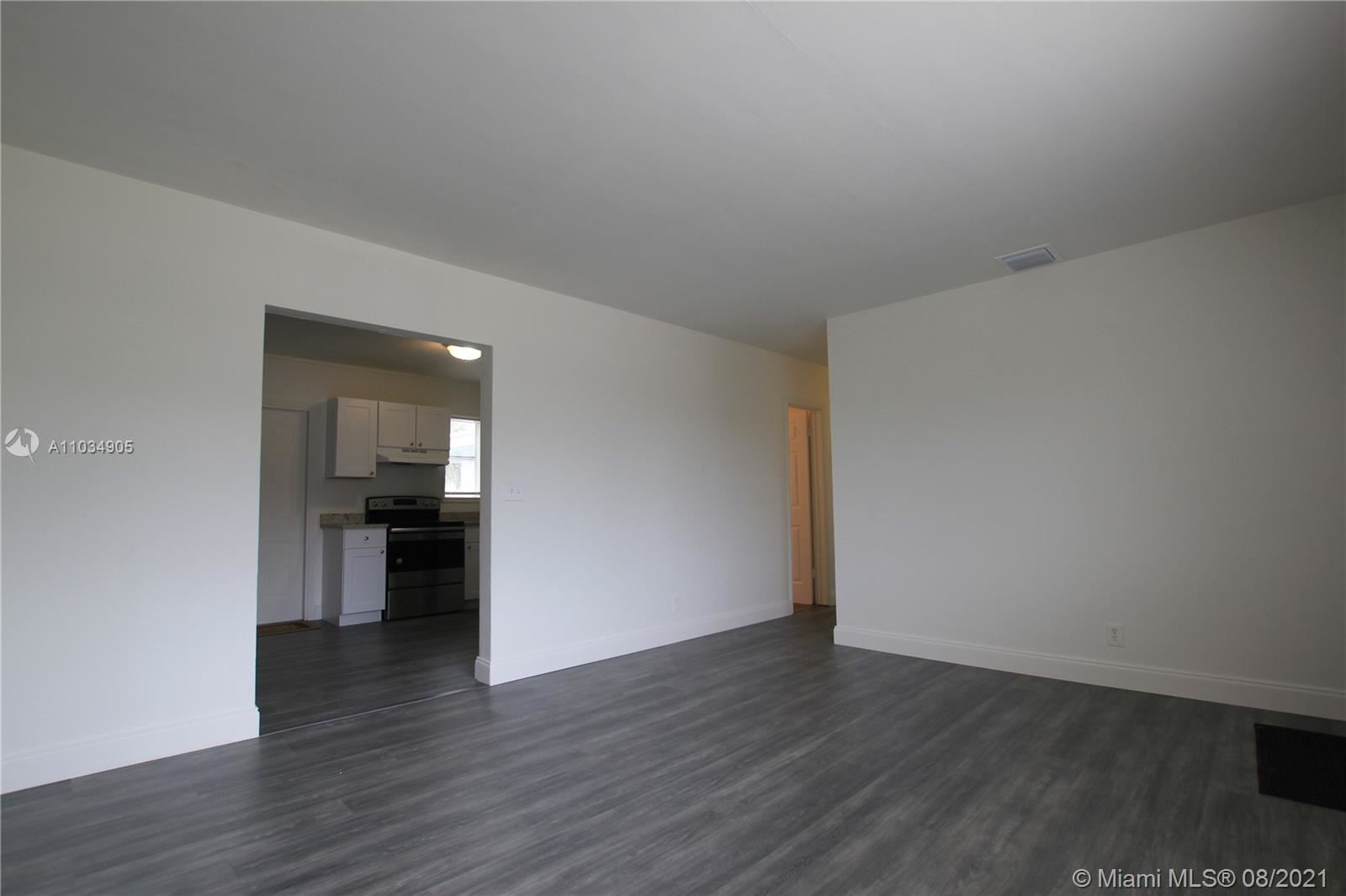 Photo of 420 W 25th St, Riviera Beach, FL 33404 (MLS # A11034905)