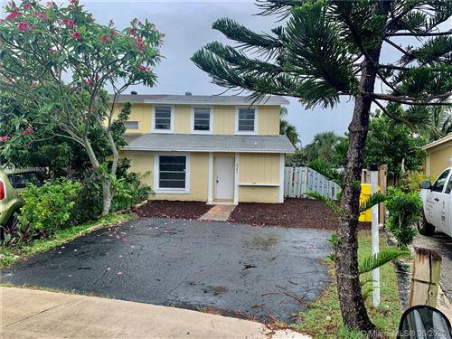 Photo of 8585 Uranus Ter, West Palm Beach, FL 33403 (MLS # A10864906)
