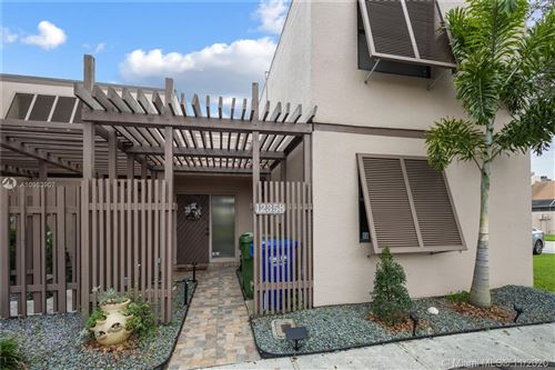 Photo of 12358 NW 11th Ct #12358, Pembroke Pines, FL 33026 (MLS # A10963907)