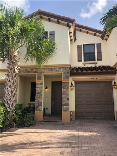Photo of 4078 Devenshire Ct, Coconut Creek, FL 33073 (MLS # A10964908)